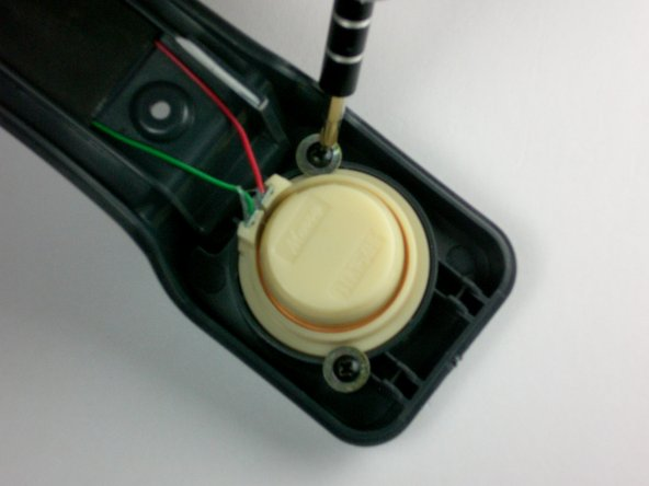 Unscrew the 2 screws (8 mm long) that hold the receiver in place using a #1 Phillips screwdriver.