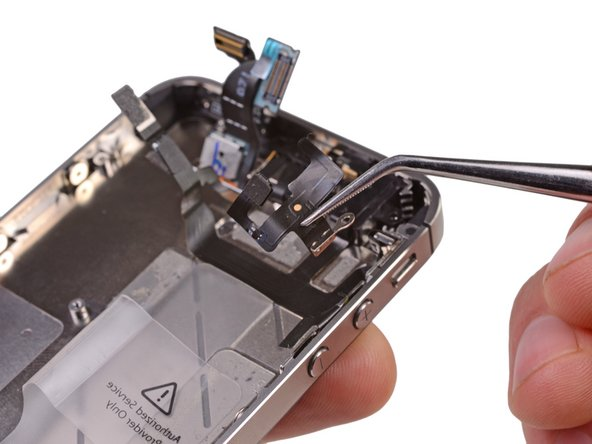 Use a pair of tweezers to remove the upper antenna from the iPhone.