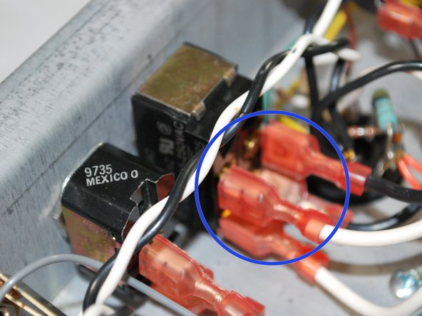 There should be four wires to remove, two white and two black. Be sure to keep track of where each was connected, since you will have to reconnect them in the same way. The picture show the white wires on the left and the black wires on the right of the switch.