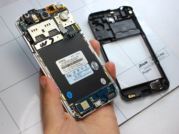 Carefully remove the midframe assembly from the display casing by pulling up and away from the phone.