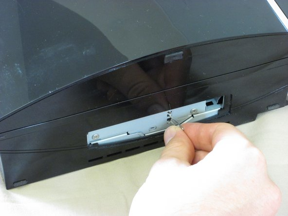 Pull the tab to slide the hard drive enclosure to the right.