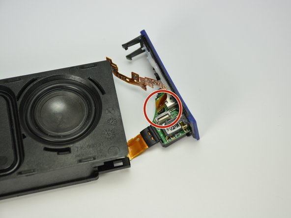 Reconnect the button ribbon connector on the top of the port assembly.