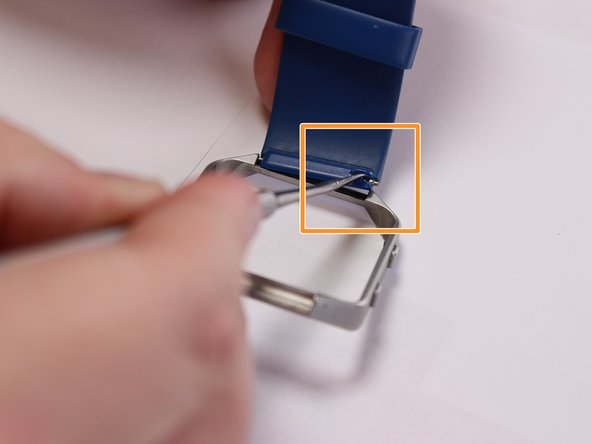 Insert the pointed end of the metal spudger into the pin hold and push it into opposite direction.