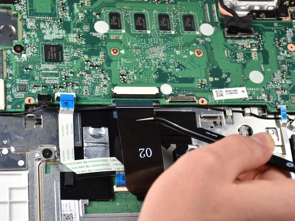 Using tweezers,  pull the single cable near the top left  of the motherboard  from its socket.