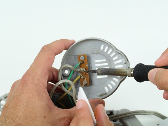 Use the soldering iron with caution. Don't touch the tip of the soldering iron to avoid the risk of injury.