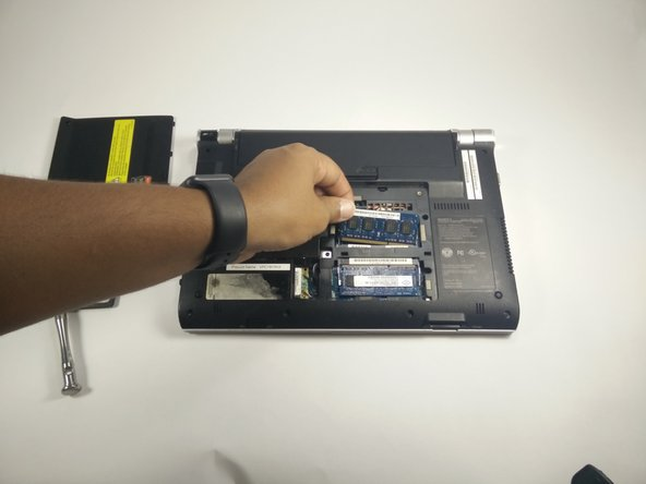 Image 2/2: Slowly remove the chip from the device