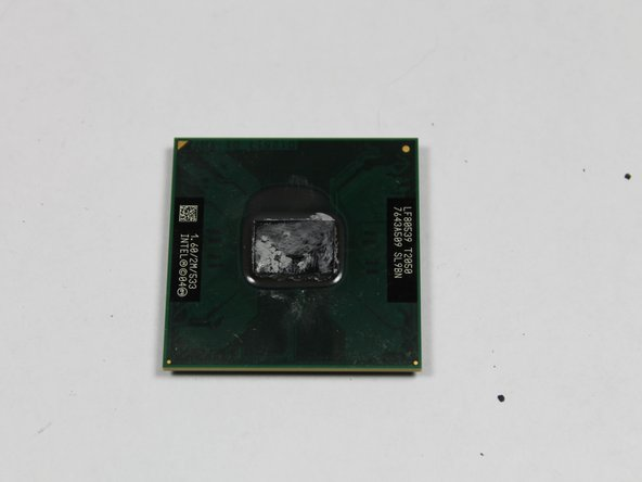 Hold CPU by the sides so you do not damage the small pins.