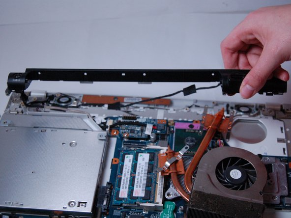 Image 2/2: Be careful to not pull any wires out while moving the cover.