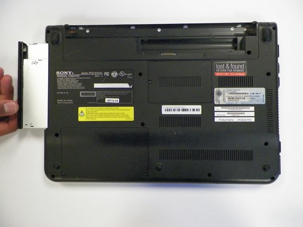 Grab and slide out the optical drive to remove.