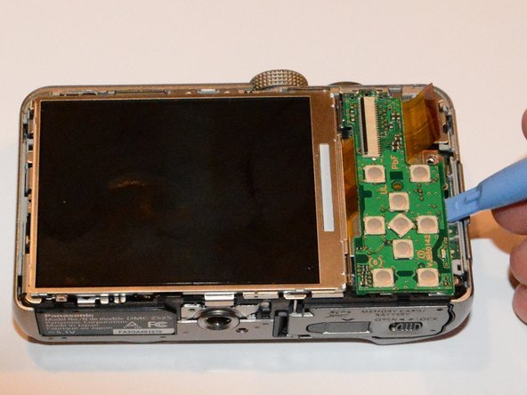 Once you unlock the screen cable, use the plastic opening tool to lift the buttons board away from the circuit board.