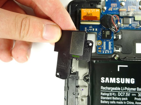 Lift and remove the speaker from the device once the screws have been removed.