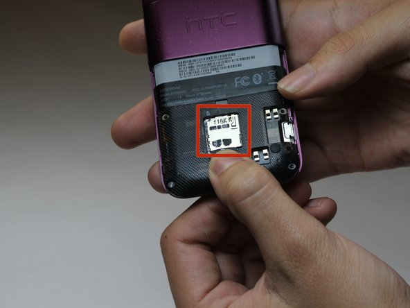 Slide the SD card out of its casing.