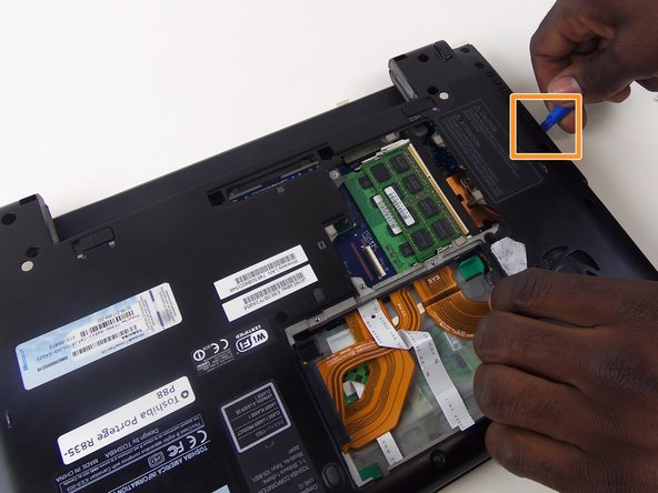 Start by removing the back cover by removing the screws, revealing the Optical Drive. Remove the 1 cm screws to remove. Then use the spudger to pry the back off.