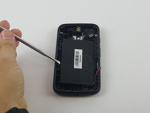 Use a spudger to gently pry up the battery.