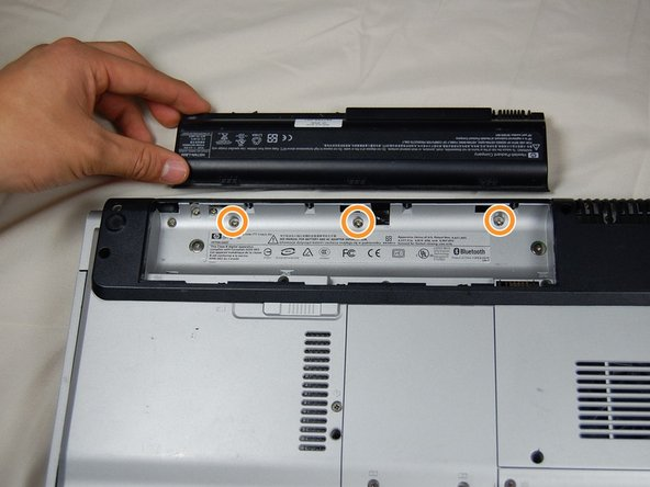 Image 1/1: Remove the highlighted screws.