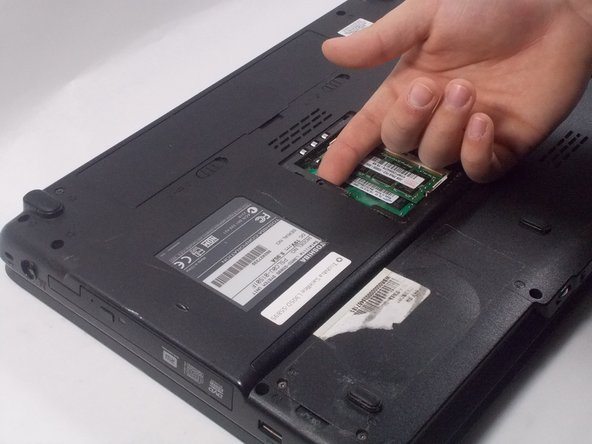 Push out CD Drive using your finger.