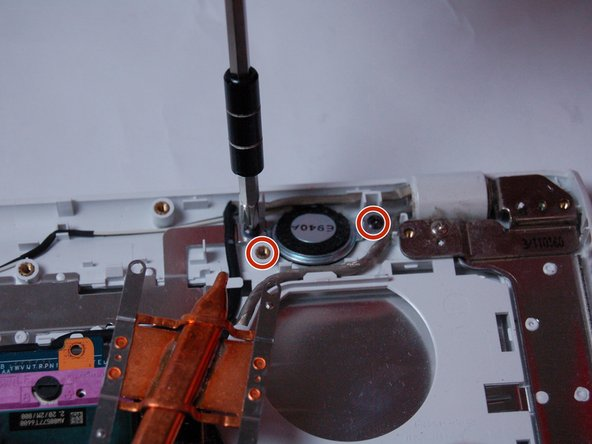 Image 1/3: Follow the wire until you find the ribbon cable that holds the wires and pull straight out of the connect to remove it.