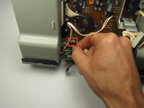 Unplug the 3-pin connector for the infrared sensor by pulling in the direction of the cable.