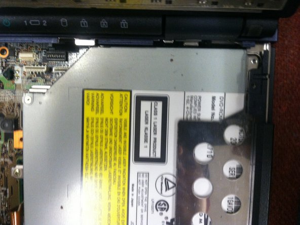 Remove first screw from the DVD drive with Philips screwdriver. Refer to photo 1 for screw's location.