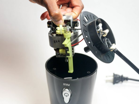 Lift up the motor and remove it from the blender.