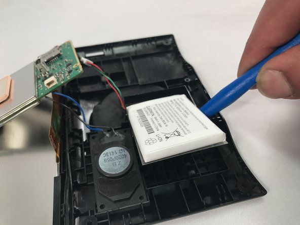 Use blue plastic opening tool to carefully pry the battery from the GPS.
