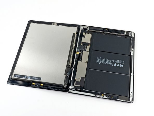 Rotate the LCD along its left edge and lay it down on top of the front glass panel.
