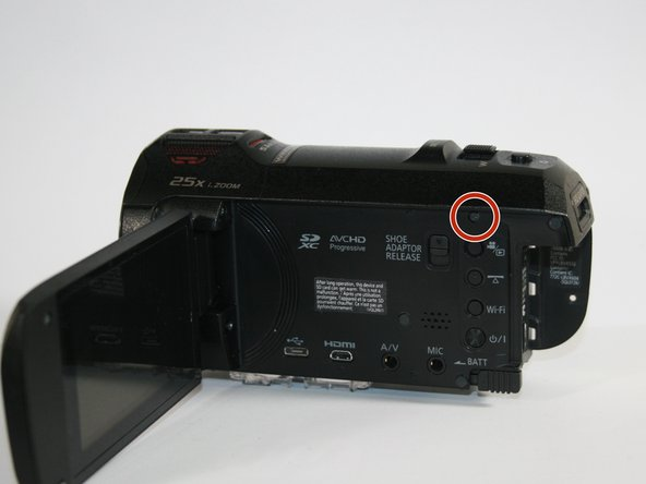 Unscrew the indicated screw on the right side of the camcorder.