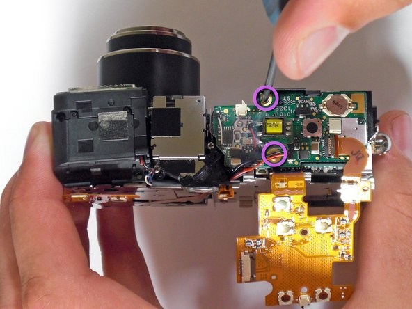 With a Phillips #00 Screwdriver, unscrew the flash board.