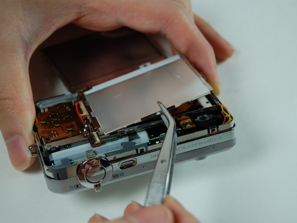 The casing may possibly be attached to LCD screen. If so, leave attached to screen.