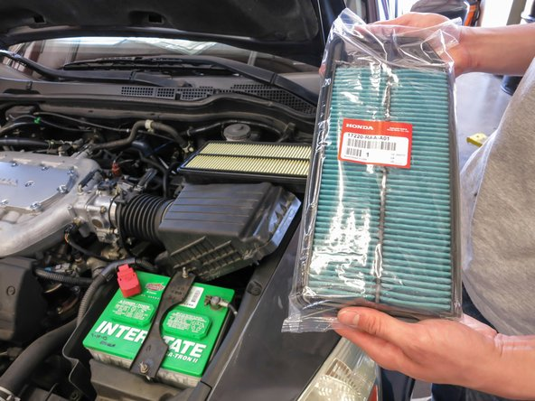 Replace the old air filter with a new one. The blue side should be facing down.