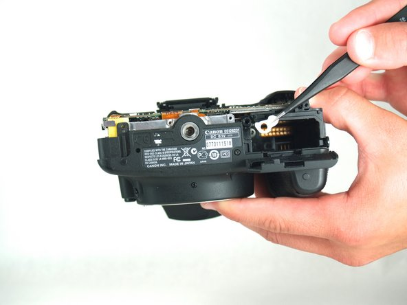 There is a spring underneath the battery notch. Do not lose this spring or let it fall off.