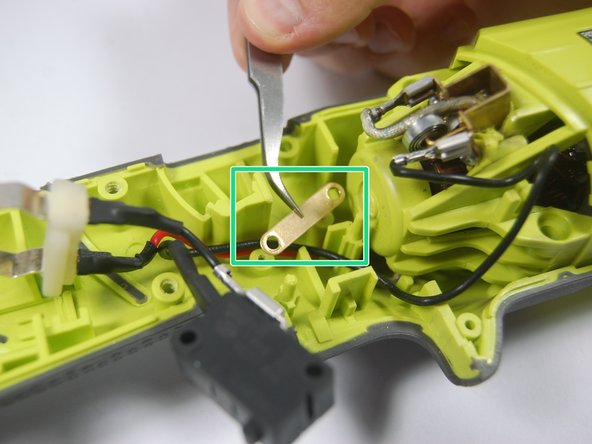 Image 3/3: During reassembly, remember to keep the spring inside the main trigger and against the bracket that is visible in the second of the accompanying photos.