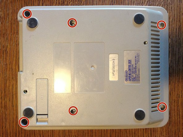 Remove the six screws located on the underside of the system with a 4.5mm Gamebit screwdriver.