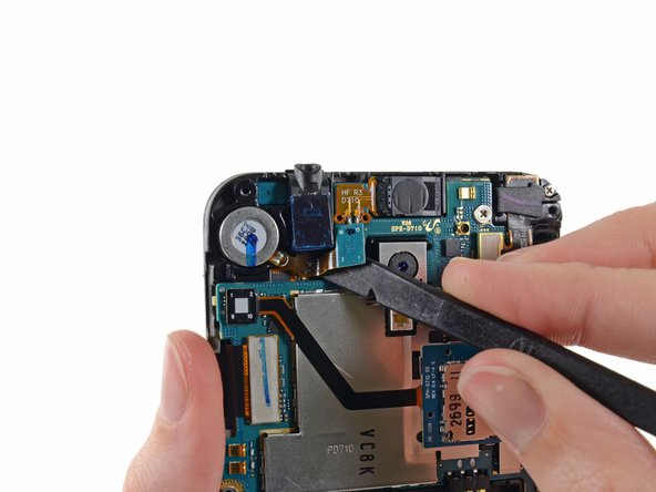Use the flat end of a spudger to release the headphone jack from the adhesive securing it to the midframe.