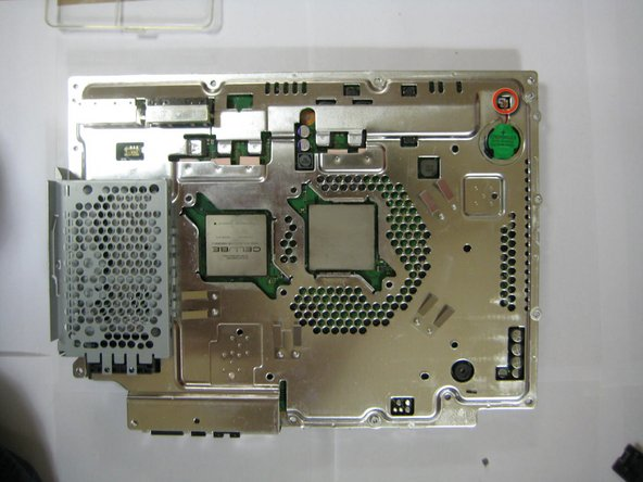 Image 2/2: To expose the mainboard, remove the watch battery from the mainboard.