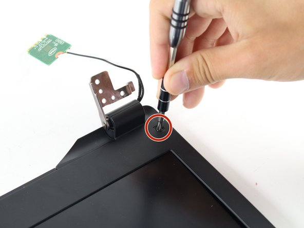 Using the Phillips #1 screwdriver, remove the 5 mm screws from both sides of the screen.