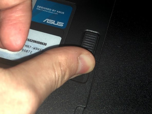 Make sure the computer is off and turn it over on its back. Push the slider all the way back until the compartment for the battery opens. Remove the battery and place it aside.