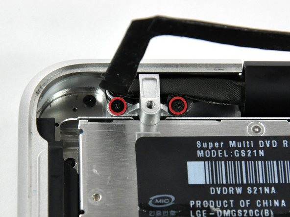 Image 1/2: The rightmost screw may remain captive in the camera cable.
