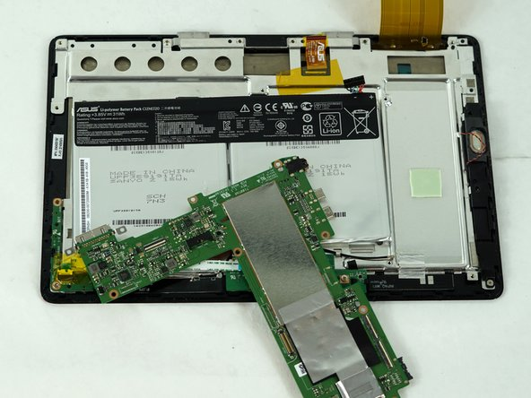 Image 2/2: Remove the motherboard.