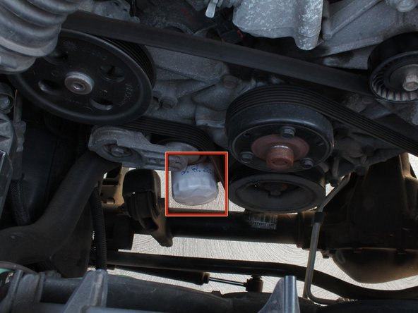 Image 1/1: Use the oil filter wrench to tighten the oil filter until it is secure.  This will prevent leaking.