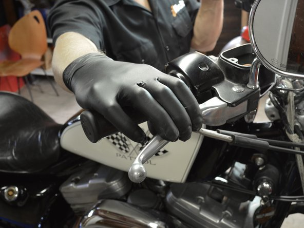 Image 1/3: Carefully pump the brake lever a few times to build up pressure in the brake lines.
