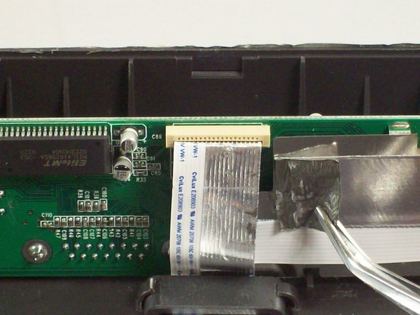 Use tweezers to gently remove the ribbon cable from the circuit board.