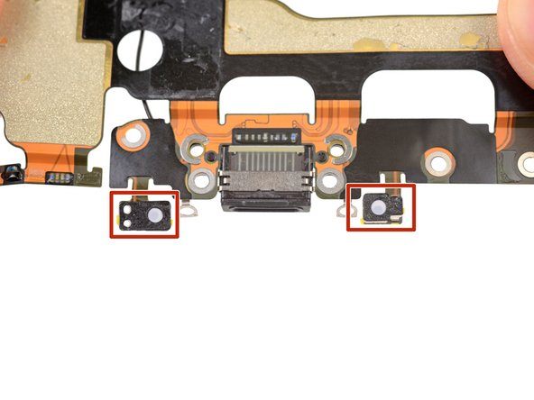 The small adhesive patch on the bottom of each microphone also protects your iPhone from liquid and dust intrusion. For best results, replace the two adhesive patches before installing your Lightning connector assembly.