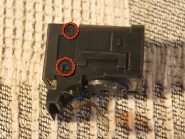 Image 2/2: Detach the electronic viewfinder atop.