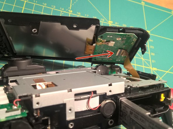 Now the two metal covers will get loose. Start by removing the back-cover containing the LCD.