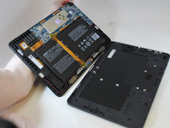Starting from the corner of the tablet, use a jimmy to create a gap between the screen and the back covering.
