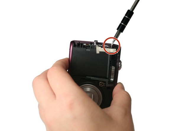 Using the Philips #000 head screwdriver, remove the 3.30 mm screw located on the side of the camera near the lanyard mount.