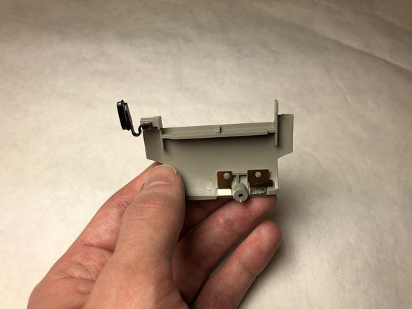 Hold the side button housing with one hand and hold the side button with the other.