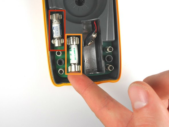 Replace a fuse only with a fuse identical in type, voltage rating, and current rating as specified by the back panel fuse rating label or the Fluke 77 Series III Service Manual. Inserting the wrong replacement fuse could create a fire hazard.