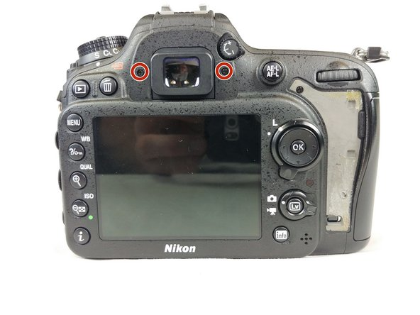 Remove the 2 screws on each side of the view finder.